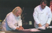 Candy Wallace and ACF President Ed Leonard sign certification agreement.