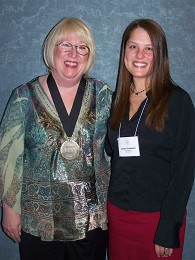 Candy Wallace (l.) receives the Foodservice Educator Network International's 2010 Medallion of Excellence from Lacey Griebeler, managing editor of Chef Educator Today